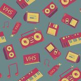 Seamless pattern with old school things. Colorful background with synthesizers, tape recorder, phone and other elements. Seamless pattern with old school things Stock Photo