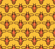 Seamless pattern with orange bees in Monoline style. Stock Photos