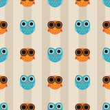 Seamless pattern with orange and blue owls on striped background. Cute and simple seamless pattern background with blue and orange stylized cartoon owls and a Royalty Free Stock Images
