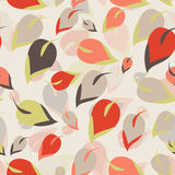 Seamless pattern. Orange, brown, green leaves on a beige background Stock Photography