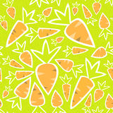 Seamless pattern orange carrots on a green Stock Photography