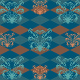 Seamless pattern with orange flower pattern on a dark blue Rob in the background. Texture Stock Image