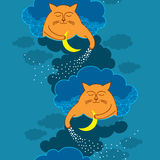 Seamless pattern with orange Funny cats on a blue background Royalty Free Stock Photography