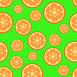Seamless pattern with orange. On a green background Royalty Free Stock Image