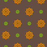 Seamless pattern with orange and green ethnic rosettes on a brown background Stock Photography