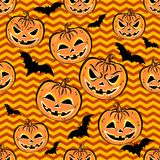 Seamless pattern with orange halloween pumpkins and bats. On yellow background. Halloween design template for scrap-book paper, textile print, page fill. Vector Stock Photography