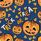 Seamless pattern with orange halloween pumpkins and candies. Seamless pattern with orange halloween pumpkins, candies and text Trick or Treat on blue background Stock Photo
