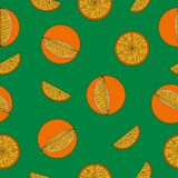 Seamless pattern with oranges. Seamless pattern with oranges on a green background Royalty Free Stock Photos