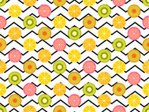 Seamless pattern with oranges, kiwi and lemon. Fruit on a background with zigzag lines. Vector Stock Images