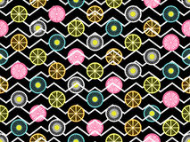 Seamless pattern with oranges, kiwi and lemon. Fruit on a background with zigzag lines. Vector Stock Photography