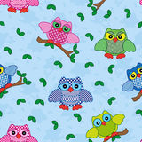 Seamless pattern with ornamental owls over blue Royalty Free Stock Photo