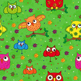 Seamless pattern with ornamental owls over green Stock Photo