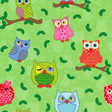 Seamless pattern with ornamental owls over light green Royalty Free Stock Image