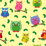 Seamless pattern with ornamental owls over yellow Royalty Free Stock Photo