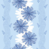 Seamless pattern with ornate chicory flower in blue on the light blue background with stripes. Floral background in contour style Royalty Free Stock Images