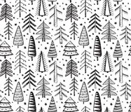 Seamless pattern with ornate Christmas trees. Stock Image