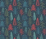 Seamless pattern with ornate Christmas trees. Royalty Free Stock Photos