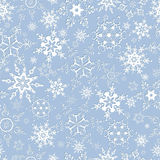 Seamless pattern with ornate snowflakes. Blue-grey beautiful seamless pattern with white ornate snowflakes. Stylish trendy seamless wallpaper for New Year and Stock Photos