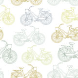 Seamless pattern with outline vintage bicycles Stock Images