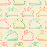 Seamless pattern with outlined rabbits. (Easter bunny) in creative ethnic style. Happy babyish color palette vector illustration