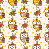 Seamless pattern with owls. Stock Photos