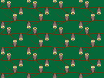 Seamless pattern with owls. On branches Stock Photos