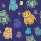 Seamless pattern with owls. Seamless pattern with varicolored owls on dark blue background. eps 10 Royalty Free Stock Images