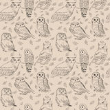 Seamless pattern with owls and wild forest leaves Stock Image
