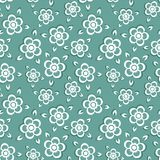 Seamless pattern with painted flowers on a green background. Stock Images
