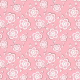 Seamless pattern with painted flowers on a pink background. Stock Photos