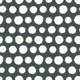 Seamless pattern with painted polka dot texture Royalty Free Stock Image