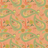 Seamless orange pattern with paisley and flowers. Vector background. Stock Photography