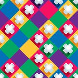Seamless pattern from paper crosseson a colored background Royalty Free Stock Image