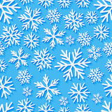 Seamless pattern with paper snowflakes. On blue Stock Image