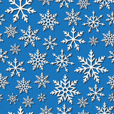 Seamless pattern with paper snowflakes. Vector Seamless pattern with paper snowflakes on a blue background Royalty Free Stock Photography