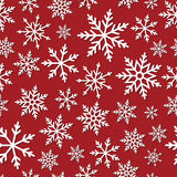 Seamless pattern with paper snowflakes. Vector Seamless pattern with paper snowflakes on a red background Royalty Free Stock Images