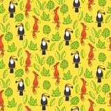 Seamless pattern with parrots and tucans. Stock Photos