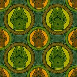 Seamless pattern with paw and claws. Made in a decorative manner and boho style in yellow, green, orange colors Stock Photography