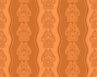 Seamless pattern with paw and claws. Made in a decorative manner and boho style orange-brown colors Stock Photos