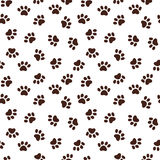 Seamless pattern with paw footprints Stock Photos