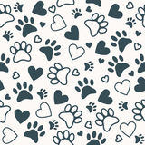 Seamless pattern with paw and heart prints. Animal footprint background