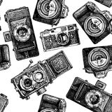 Seamless pattern with photo cameras Royalty Free Stock Photo