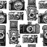 Seamless pattern with photo cameras Stock Image