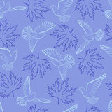 Seamless pattern with pigeons and leaves on a blue background Stock Images