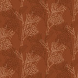 Seamless pattern with pine branches on a brown background Royalty Free Stock Photos