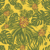 Seamless pattern with pineapples. And palm leaves Stock Photography