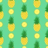 Seamless pattern with pineapples and pineapple slices on mint green background. Pineapple background. Bright tropic. Fruits illustration Royalty Free Stock Images