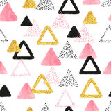 Seamless pattern with pink, black and golden triangles. Stock Image