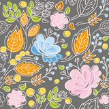 Seamless pattern, pink, blue flowers, orange leaves on a dark gray background. Stock Photography