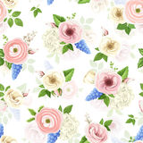 Seamless pattern with pink, blue and white flowers. Vector illustration. Stock Photos